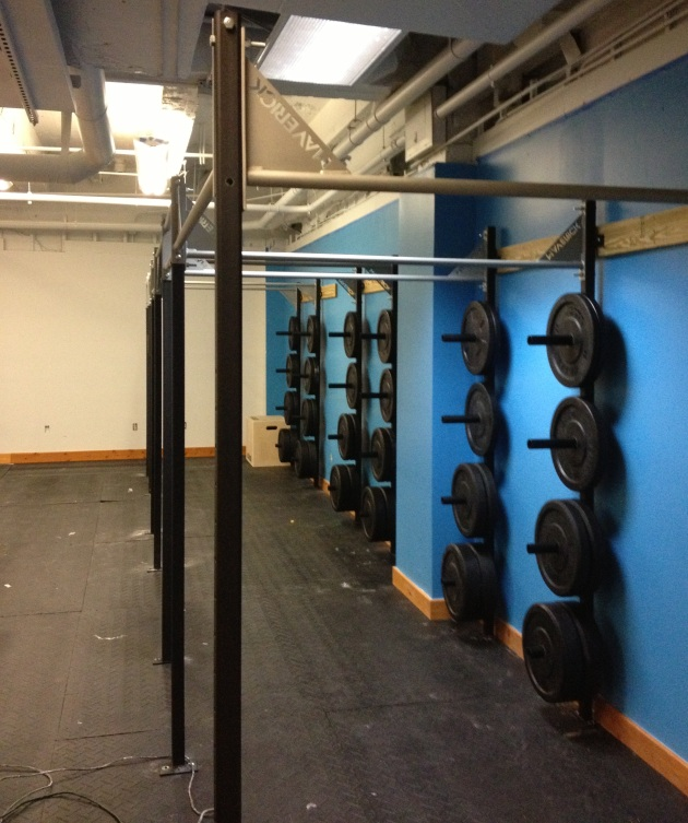 After painting the entire space we installed our 30 ft pull up rig. We are really exicted about the weight storage. It is solid and officially ready for WODs